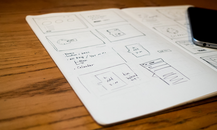 wireframe in notebook with phone